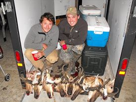 Matt and Cole celebrating with a cup of whiskey after a successful Antelope hunt in Wyoming.
