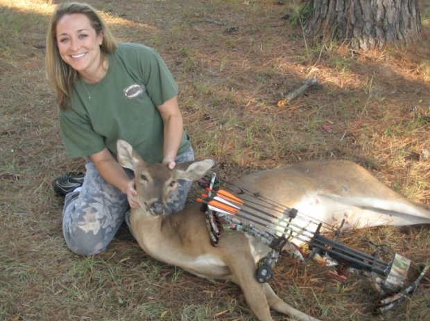 Jessica with her first bow kill after only a single hunt and single shot bow hunting.