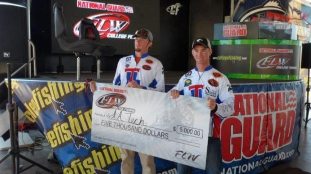 "Holding the ""big check"" after their win at the FLW Sam Rayburn Reservoir Invitational."